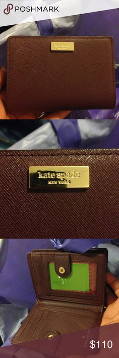 Kate Spade Laurel Way Cara wallet in Mulled Wine Brand new! With original tags still attached! Makes a beautiful birthday or Mother's Day gift! Please make your offers through the offer button, I don't discuss prices in comments! Please keep in mind the 20% commission fees when making offers. kate spade Bags Wallets