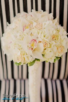 bridal bouquet; white hydrangea, orchids and roses....
