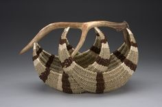 "Leslee Burtt, Artist, elk antler with reed, seagrass, dyed coir. 30"" wide x 14"" deep x 22"" high"