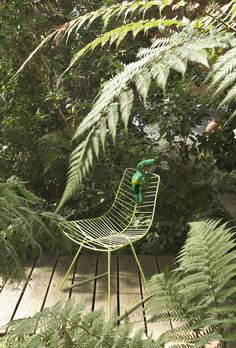 Jungle green chair in the garden   More photos http://petitlien.fr/outdoorpaintings
