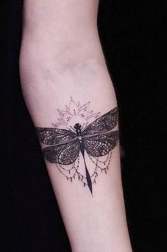 dragonfly tattoo on arm