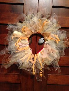 """DIY lion's mane: Elastic, tulle, fleece, ribbon, felt, headband, glue gun.  Cut tulle to desired length and loop around elastic as if making a tutu.  Use ribbon and fleece to add color and texture.  Glue tulle-covered elastic onto headband.  Add felt ears in front and felt """"mane"""" in back. Connect open elastic ends with fleece """"strap"""" and glue ends shut."""