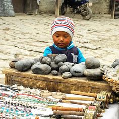 Isn't this the youngest and cutest salesman ever? - #muktinath #childrenofnepal #trekking #vacation #walking #hiking #annapurna #mustang #mountains #souvenirs #whitemountains #monastry by henja1