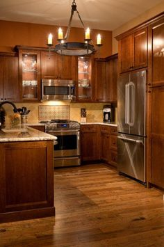 This is a good idea of how your kitchen would look, with wood on wood. :) http://www.ChicagoHouseBuzz.com - Wood on Wood Kitchen