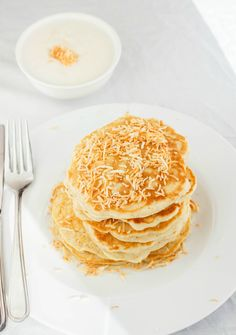 Throw away that boxed stuff and try these homemade toasted coconut pancakes instead! The recipe can easily be made vegan.