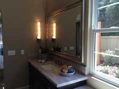 Framed mirrors in bathroom