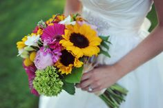 A dynamic mix of color...sunflowers, garden roses, gerberas blending favorites of the bride.