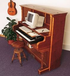 Piano desk. I so want...so need! (Minus the old CRT monitor)