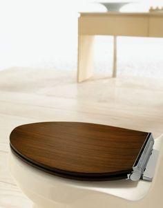 wood toilet seat cover. like.