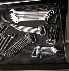 Wrenches on caribiners  Caribiners  Easily the single-best way to organize box-end wrenches, a $1 'biner from Harbor Freightor the checkout aisle at Lowes gives you a zero-extra-space solution for keeping your SAE and metric apart and in order. They transport easily, making it easier to just grab the whole set as you walk out to the car. Itty-bitty key chain sized ones will work for your tiny wrenches, and big ones work for the big ones. You might even notice your Crescent wrenches have a…