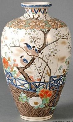 Japanese Satsuma shouldedvase, design of birds in a flowering prunus tree and hollyhocks against a basketry fence, Japan, circa 1876-1900