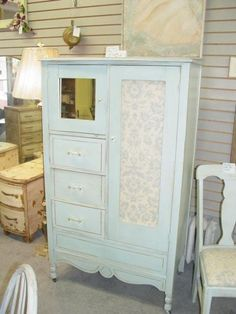 Vintage wardrobe re done. Soft blue an white with a touch of fabric added.