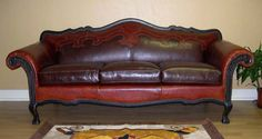 Winchester Leather Sofa Western Sofas and Loveseats - Leather western 3 cushion sofa with designer styling. Richly distressed red leather with yoke design combines beautifully with chocolate brown leather. You'll appreciate detailing like the unique carved arms and scalloped back, special stitching and nail head trim.