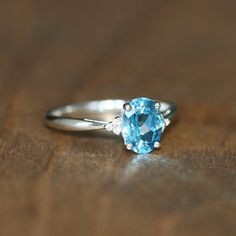 3 Stone Swiss Blue Topaz Ring in 10k White Gold Topaz by LuxCrown