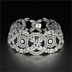 "The jeweller Robert Procop put on the Antique Diamond ""Elise"" Choker  for Angelina Jolie."