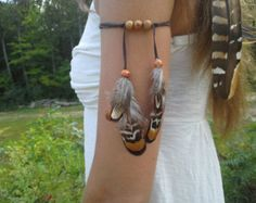New to dieselboutique on Etsy: Real Feather Armband Native American style upper arm indian Feathers Indian Warrior free people tribal armband woodland armlet USD) Native American Fashion, Native American Jewelry, American Clothing, Hair Jewelry, Boho Jewelry, Tribal Jewelry, Bracelet Bras, Arm Bracelets, Tribal Armband