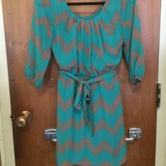 Patterned Mid-Legnth Dress Patterened mid-legnth dress. Teal and brown. Wrap around waist tie Lily Rose Dresses Midi