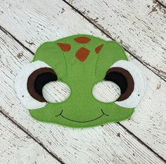 Turtle Mask Fun for kids from 3+. Fits most children from 2-12. All masks come with a 12 elastic attached. -Measures approximately 7 x 5 inches. -Made with two layers of eco felt, machine stitched and cut by hand. Some wool blend felt used, please let me know if you need all non-wool felt -Comes with 12 elastic attached. Please check my current turn around time before purchasing to make sure it works for your time frame. All of my items are handmade, therefore there may be a slight differ