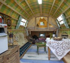 sheepherders wagon remodel with modern touches (like the electric stove vs a wooden stove)