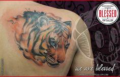 Tatuaje cover up con tigre realizado por eduardo alonso.