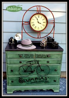 Beautiful makeover of a dresser.  The graphic on the front just absolutely makes it for me.