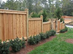 Wooden Fence Designs Ideas charming wood fence along stone wall flower beds and green grass lawns traditional yard landscaping ideas for sloping sites Wooden Fence Designs Ideas Design Wood And Natural Stone Fences Free Design News