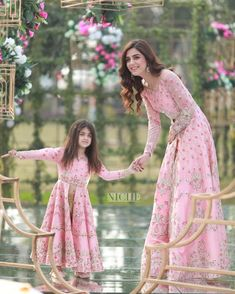 Image may contain: 2 people, people standing, text and outdoor Indian Gowns Dresses, Pakistani Bridal Dresses, Pakistani Dress Design, Wedding Dresses For Girls, Dresses Kids Girl, Mom Daughter Matching Dresses, Mother Daughter Fashion, Party Kleidung, Stylish Dresses