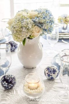 If you're looking for Easter dinner or spring table ideas, this blue and white table setting has a hydrangea centerpiece that is perfect for the occasion Brunch Table Setting, White Table Settings, Blue And White Vase, White Vases, Xenia, White Centerpiece, Simple Centerpieces, Centrepieces, Hydrangea Arrangements