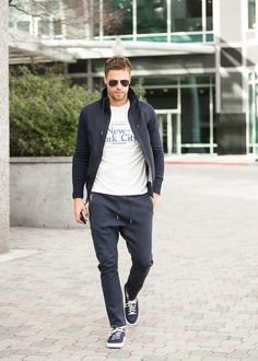 Opt for a black bomber jacket and dark grey sweatpants to effortlessly deal with whatever this day throws at you. Navy canvas low top sneakers will add a new dimension to an otherwise classic look.   Shop this look on Lookastic: https://lookastic.com/men/looks/black-bomber-jacket-white-and-navy-crew-neck-t-shirt-charcoal-sweatpants/18758   — Black Bomber Jacket  — White and Navy Print Crew-neck T-shirt  — Charcoal Sweatpants  — Navy Canvas Low Top Sneakers