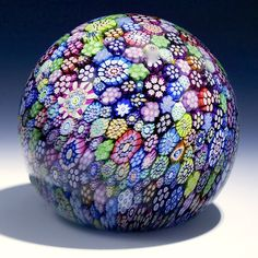 "Peter McDougal {Scotland} paperweight -  Complex millefiori canes in various colors. Signed with a ""PMCD"" signature cane 3 5/8""w x 3 1/3""t, 23.3oz. - #0340"
