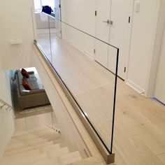 Update your hallway. Glass panel railing opens up a narrow hallway and helps create a fresh clean and beautiful feel. Update your hallway. Glass panel railing opens up a narrow hallway and helps create a fresh clean and beautiful feel. Glass Balcony Railing, Balcony Railing Design, Glass Stairs, House Staircase, Staircase Railings, Staircase Design, Glass Handrail, Glass Balustrade, Double Doors Interior
