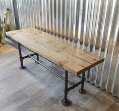 Industrial pipe bench. Made from real 3/4 iron pipe that has been cleaned and sealed. Choose from flat black pipe or flat iron grey pipe color. Top is distressed wood that has been stained. You can choose from any Minwax stain color. This listing is for a bench 3.5 long, but I can make the bench any length you specify. Just message me first for a quote. Have something else in mind? Let us know and we can build it
