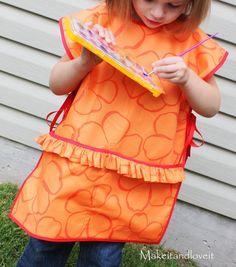An art smock ... perhaps someday I will have the time to whip ones of these out.  Maybe when MacBaby is old enough to be occupied by art projects!