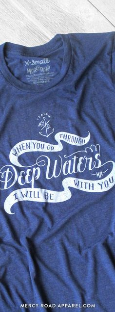 """Nautical Christian T-Shirt with Isaiah 43:2 """"When you go through deep waters, I will be with you"""". this scripture shirt is handcrafted and screenprinted on a gloriously comfy navy blue triblend tee. Quality Christian clothing for women and men. FREE SHIPPING USA. Shop >> MercyRoadApparel.com. This design is copyrighted ©️️2017MercyRoadApparel"""