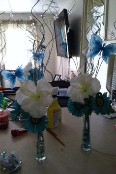Blue centerpieces- I really like the butterflies.