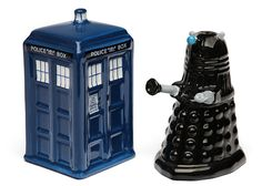 These would go perfectly with my sunflower kitchen!!   ~   Doctor Who TARDIS vs. Dalek Salt and Pepper Shakers