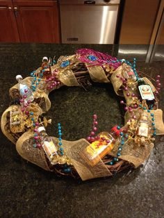 Rather than the typical liquor bouquet I made a liquor wreath for Ali's Birthday! Beer Bouquet, Liquor Bouquet, Candy Bouquet, Easy Gifts To Make, How To Make Wreaths, Diy Gifts, Handmade Gifts, Alcohol Gift Baskets, Alcohol Gifts