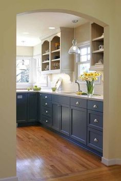 Upper cabinets one color, black splash and bottom cabinets a third color. Note hardware.
