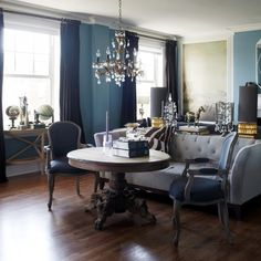 Suzie: York House - Elegant living room with blue walls paint color, gray tufted sofa, antique ...