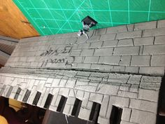 A closer look at the model castle wall w/ a standard 25mm model for reference.
