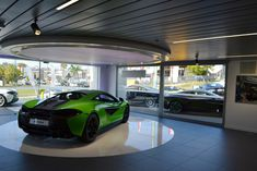 McLaren Queensland Showroom, Australia. McLaren Gold Coast by Birchall & Partners Architects. Architects with extensive experience designing and building car showrooms since 1988. Architects Ipswich | Architects Brisbane | Architects Gold Coast Brisbane Architects, Southport, Gold Coast, Showroom, Australia, Building, Car, Automobile, Buildings