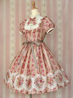 Victorian Maiden OP. This dress is so beautiful! I love the fabrics in this dress and the bib with the bow and the ruffles around it makes me drool slightly.