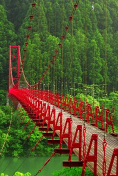 Red Truss Bridge. It is supported from the top and anchored to a sure foundation on the ends. Watch out for resonance frequency.
