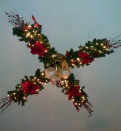 "Ceiling fan ""dressed"" for Christmas."
