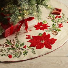 You're not going to display your family's holiday tree with the stand showing, are you? These 10 Christmas tree skirts add a festive foundational element, catching needles and holding presents, all in a super stylish way. Poinsettia Tree, Christmas Poinsettia, Noel Christmas, Handmade Christmas, Christmas Fabric Crafts, Christmas Sewing, Christmas Embroidery, Christmas Decorations, Crochet Christmas