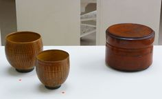 INGER ROKKJAER (1934-2008) From left: 24. Brown bowl with incised lines, 2006, raku, height 13 cm diam. 14 cm Brown bowl with incised lines, 2006, raku, height 12 cm Reddish/Brown lidded cylinder, 2004, raku, height 14 cm, diam. 19cm