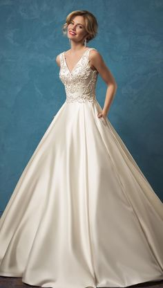 Elegant sleeveless beaded v-neck ballgown wedding dress with silk skirt; Featured Dress: Amelia Sposa