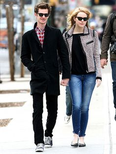 Emma Stone and Andrew Garfield sync up for a sweet stroll – and handhold! – Thursday in New York, where the actor is starring in Broadway's Death of a Salesman.