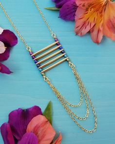 Vibrant Ladder Necklace in Gold >> Purple, Blue, and Teal Jewel Tones, Glass Beads, Long, Layering Necklace, Boho Style by MileHighBeads on Etsy #longbeadednecklacejewels