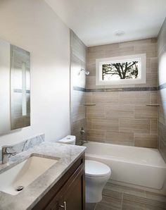 This modern style bathroom features porcelain tile surround with accent strip, espresso wood cabinet with marble countertop, Grohe plumbing fixtures and a dual flush toilet. Dual Flush Toilet, Modern Toilet, Modern Baths, Plumbing Fixtures, Marble Countertops, Modern Bathroom Design, Wood Cabinets, Home Values, Master Bath